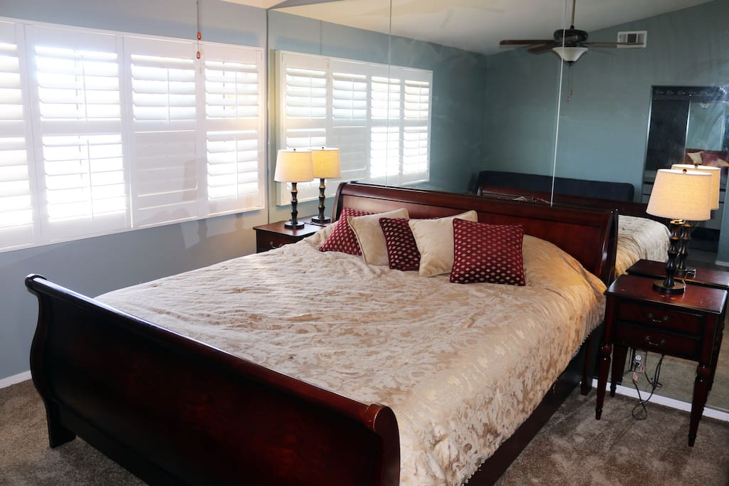 Master Bedroom features a king-size sleigh bed, with pillow top med-firm Sealy Posturepedic mattress (insanely comfortable). Additional futon in this room (not pictured) can sleep another 2. Double closets and closet organizer make for more than enough st