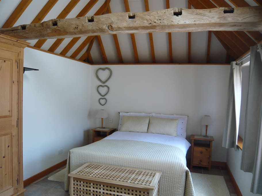 Bedroom with beams and vaulted ceiling