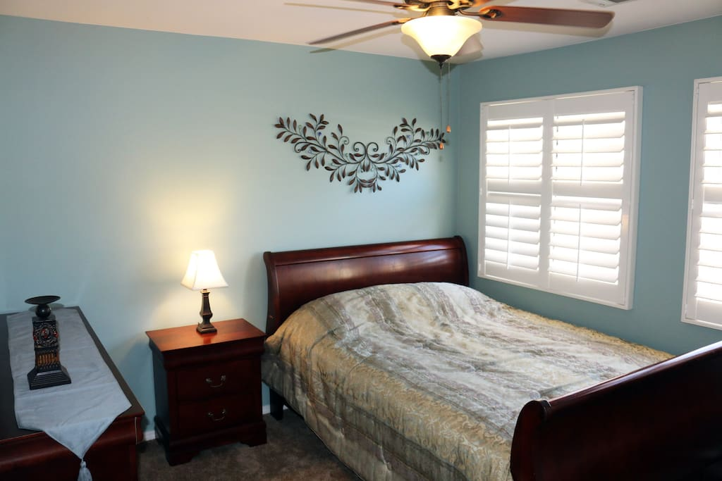 Upstairs 2nd bedroom, features an adjoining full bathroom, queen size beautyrest mattress (Firm) and sleigh bed. Full closet for ample storage, and sunrise facing windows make for a light and airy experience.