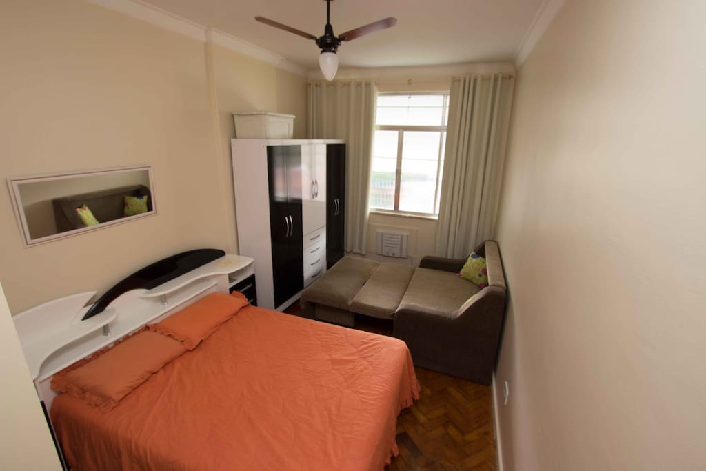 Air conditioner, overhead fan, well-lighted bedroom