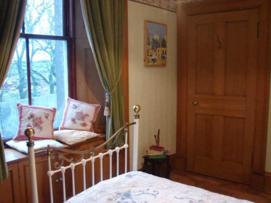 Rooms are furnished typically with iron beds, antiques and original artwork.
