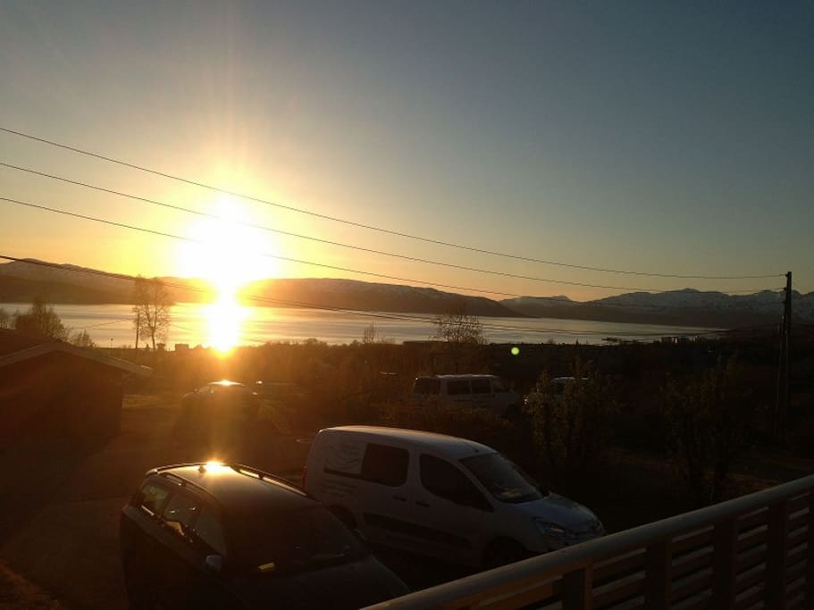 Fantastic view to the fjords with midnight sun from the terrass.