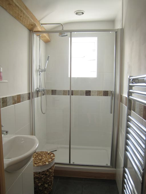 Shower room with large shower head and wand so children can be kept clean as well