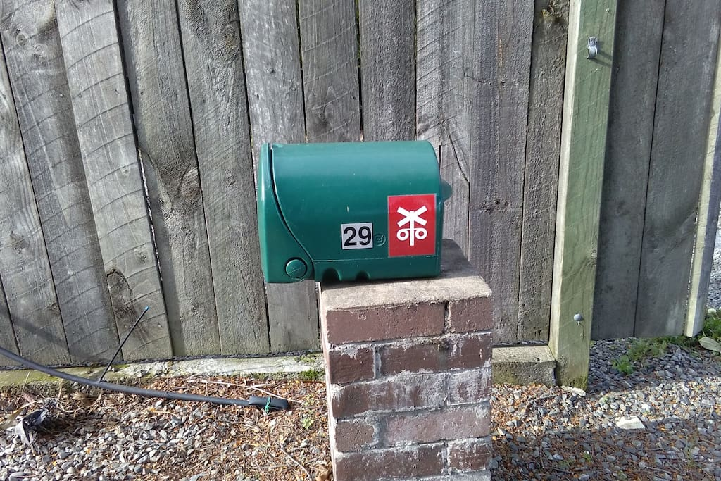 29 green letter box with railway crossing logo on, can also park close to mail box fence to allow room for car in garage to get out thanks.