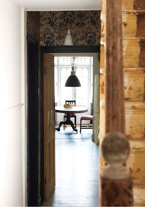 Entrance hallway and view to dining table and French doors