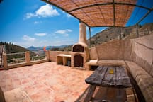 Our top terrace has further covered seating and a Pizza Oven