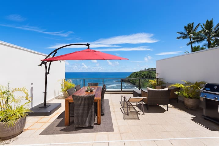 The Lanai has natural shade in the morning and afternoon but an umbrella is good mid day.