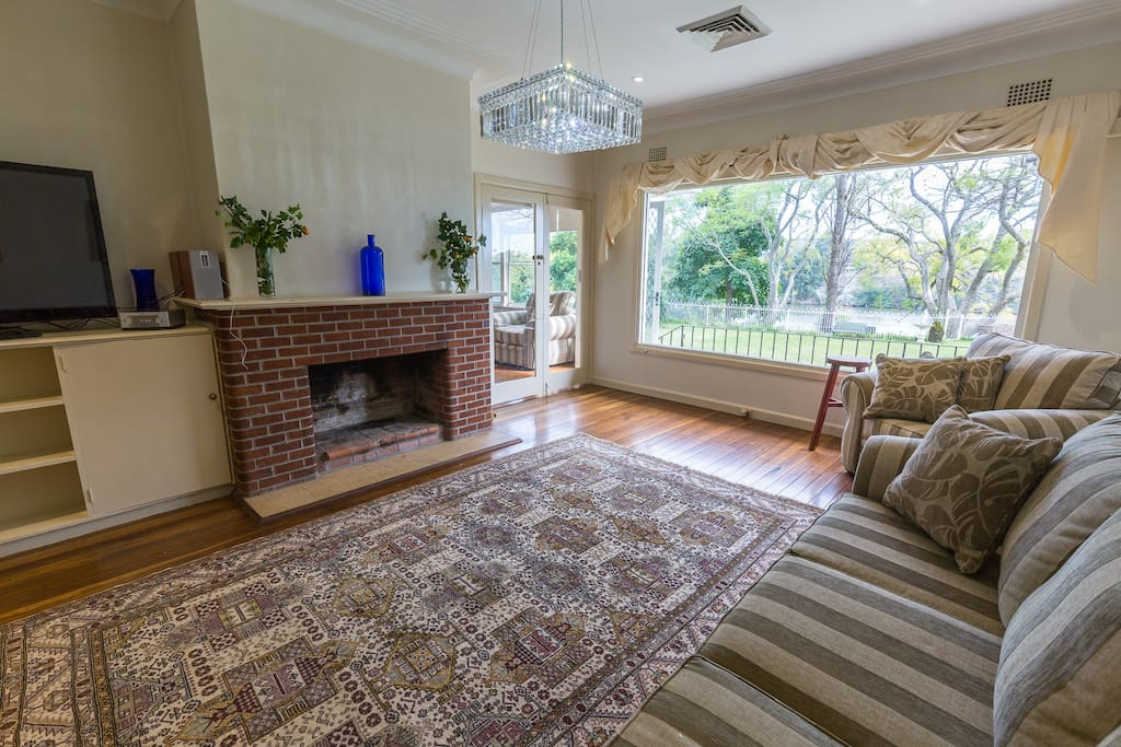 Lounge room with views out over the Nepean River & stunning sunset's