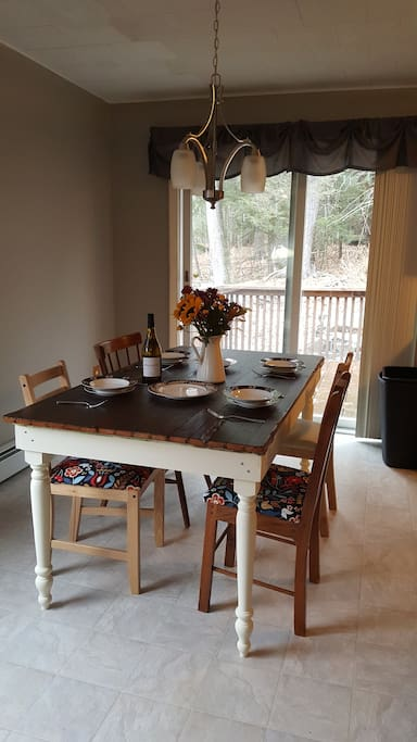 Dining Room features a rustic table owners made from reclaimed barn door.