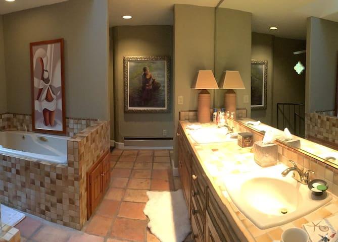 Master bath with dual sinks & beautiful art works..