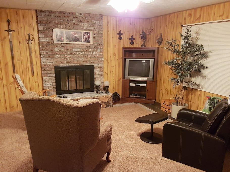 Private living room area in same room as bedroom (double futon on wall opposite fireplace)