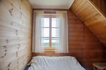 Bedroom 1 is not the biggest, but it has the most magnificent view over the fjord. Here you can wake up to a fantastic sunrise - and enjoy it with your loved one from the bed before breakfast :)