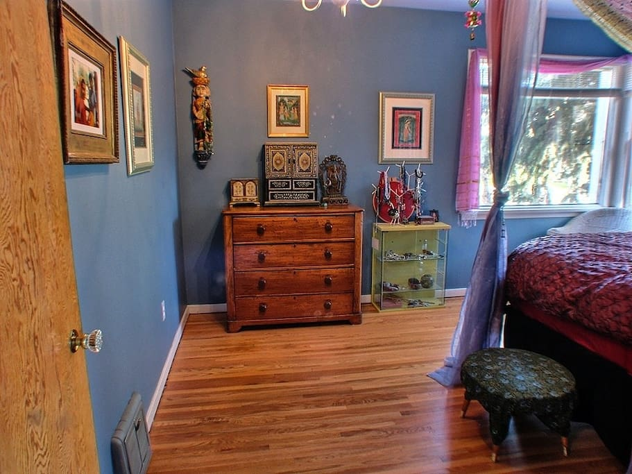 Bedroom has original hardwood floors
