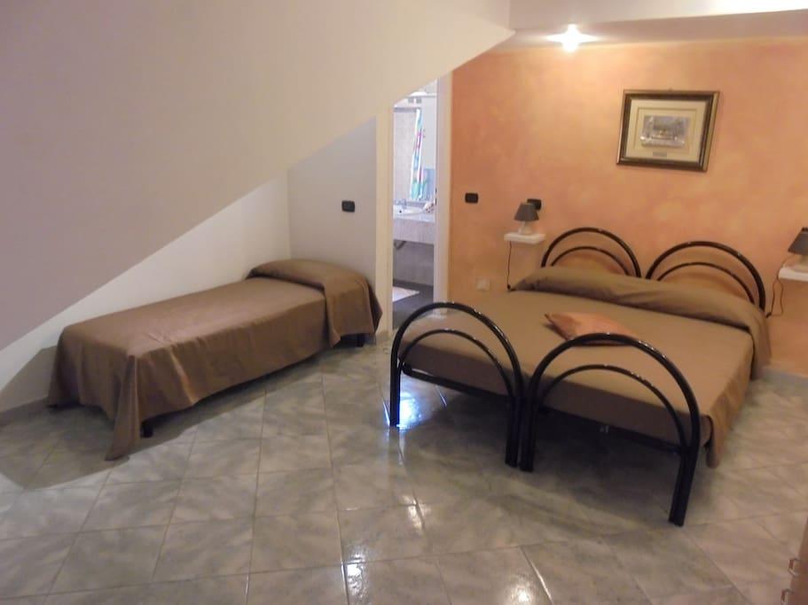 Room 1, con 4 posti letto e possibilità di aggiunta di un quinto lettino