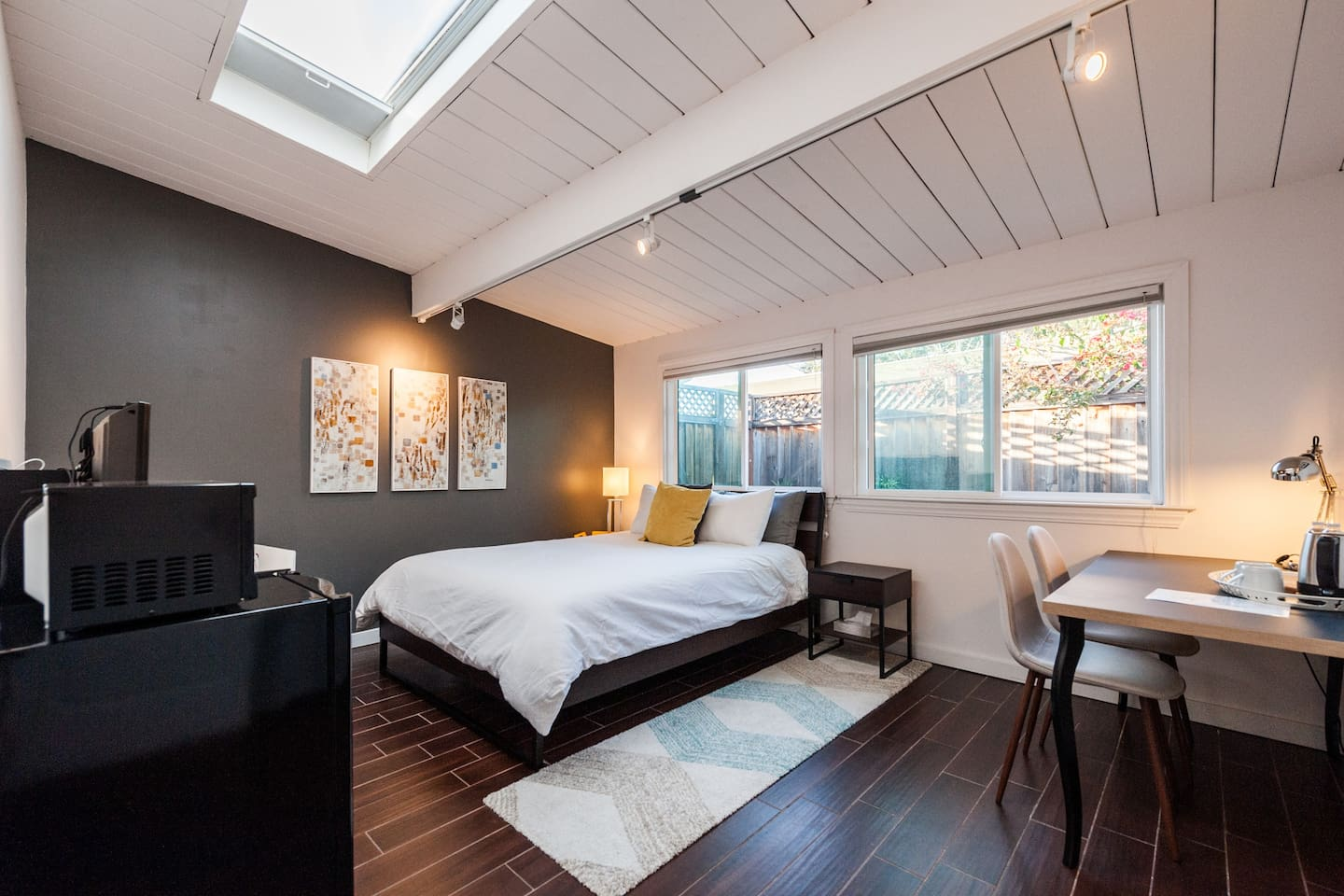 Spacious bedroom with skylight.