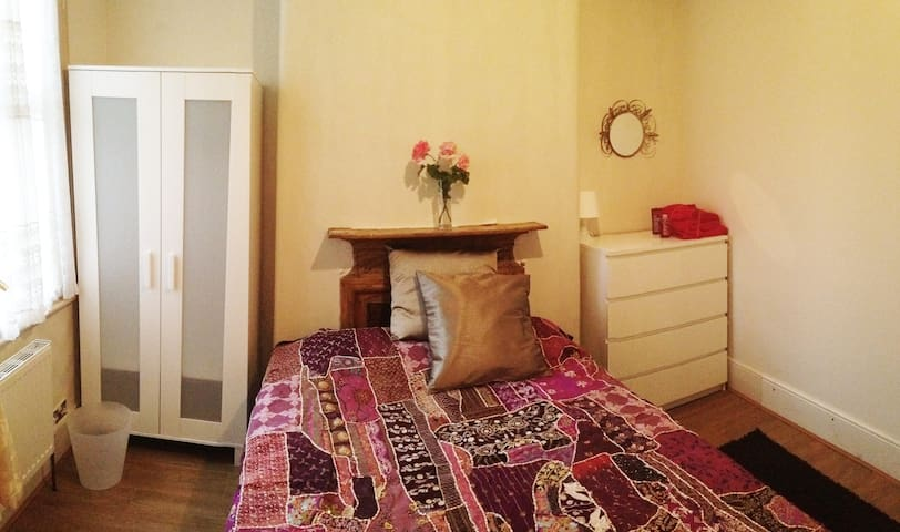 Spacious bright double bedroom with double wardrobe & chest of drawers.
