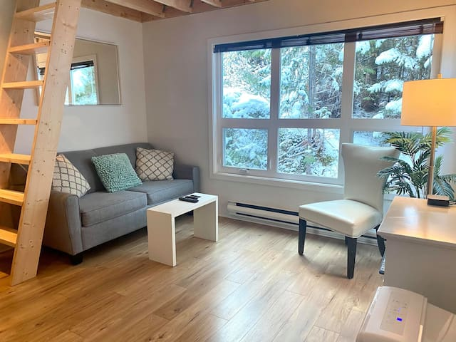 Take in the winter wonderland forest from your cozy loft