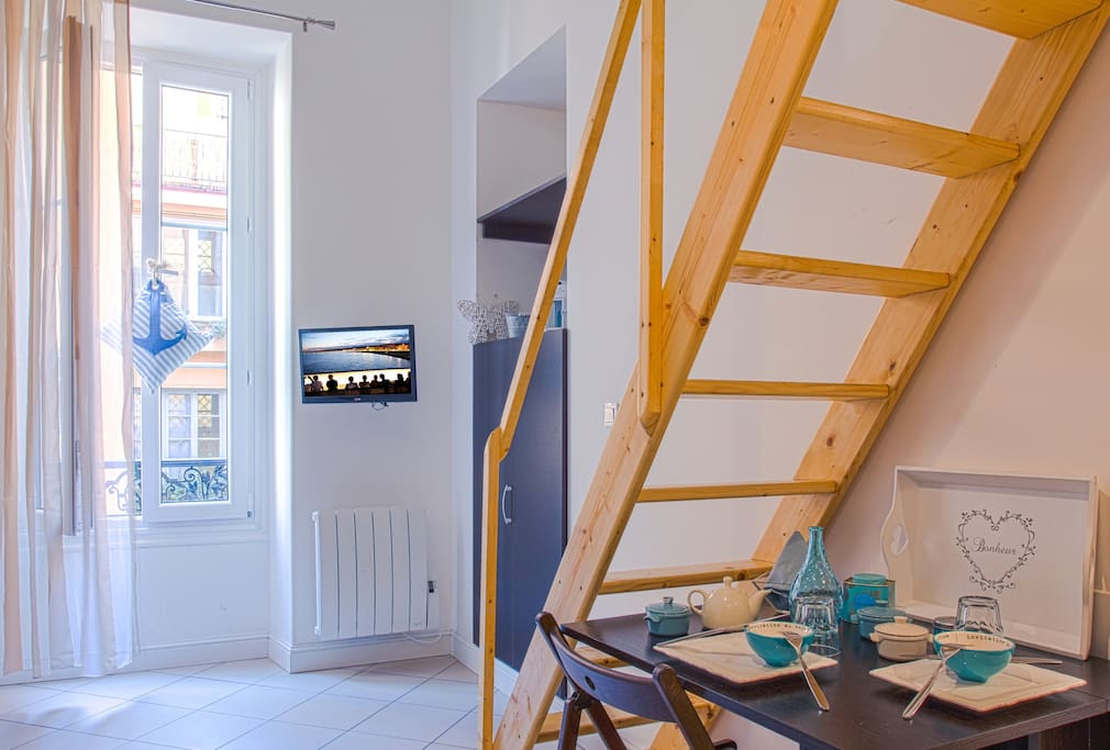 Dining table and staircase to the loft