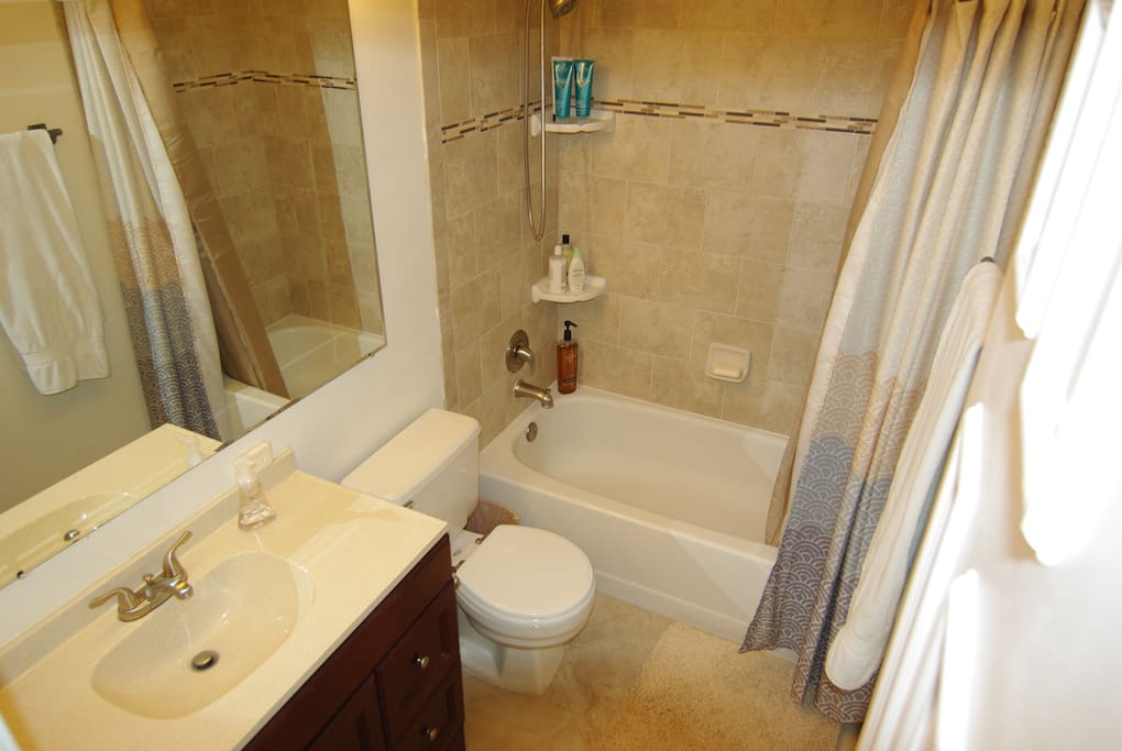 your private bath with two giant, soft towels, deluxe personal products, hair dryer and hand towel, all freshly laundered