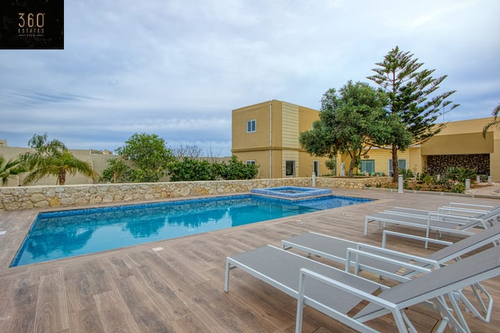 Luxurious 5BR villa with massive outdoor pool area