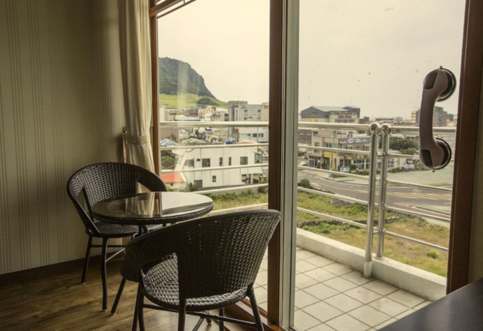 There is small table which you can enjoy beautiful tuff cone and ocean view.