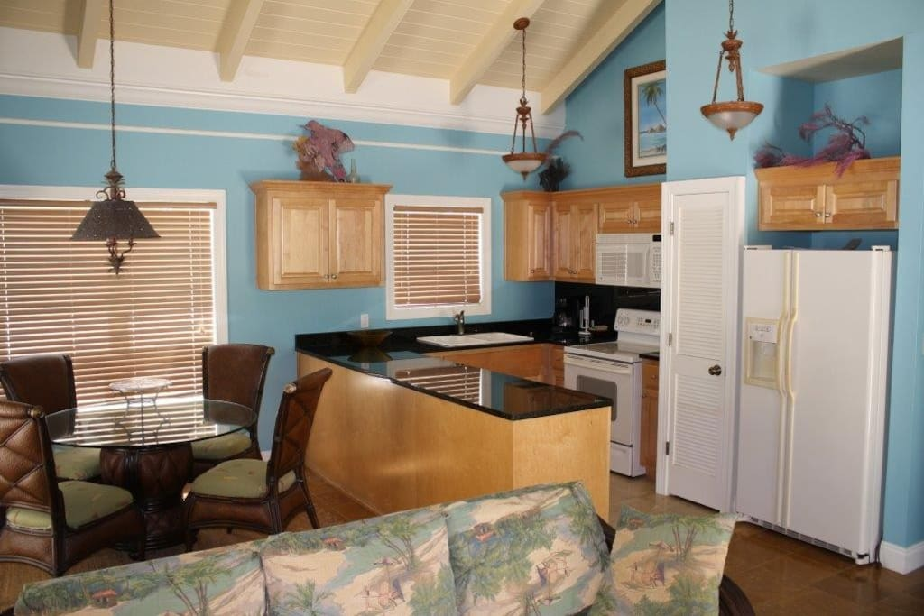 Fully equipped kitchen will full size appliances and granite countertops.