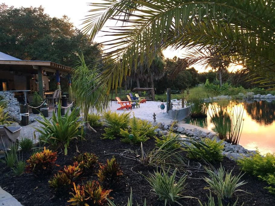 The pond and beach area at sunset.