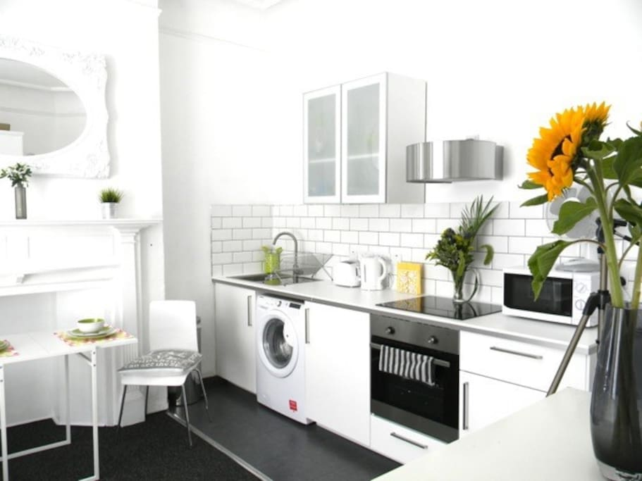 Brand new white modern kitchen, which is fully equiped