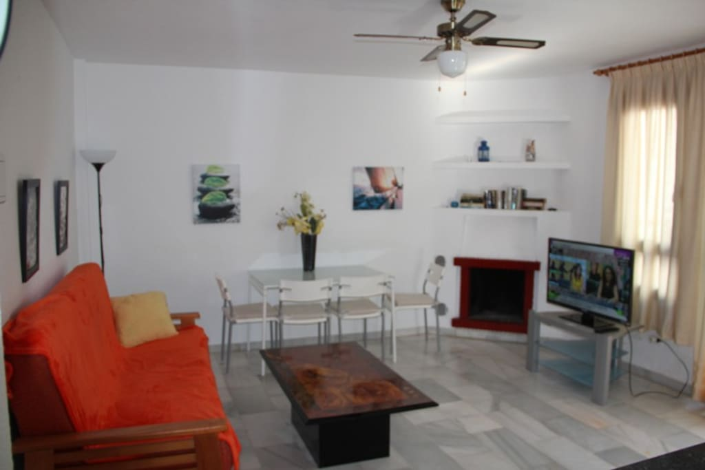 Living room with american kitchen, fire place and sofa for sleeping of 2. Has exit to the terrace