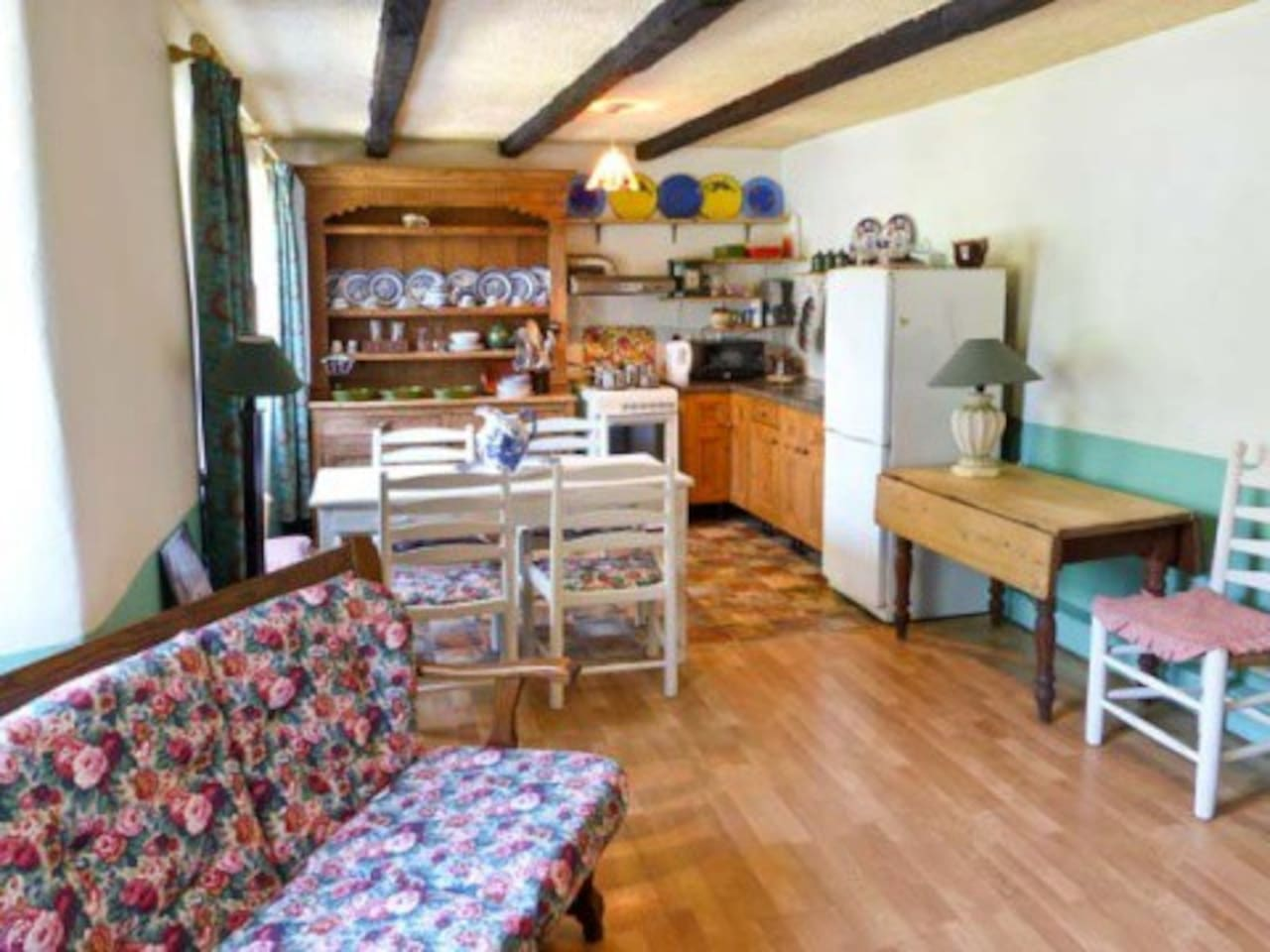 cosy kitchen living area with original 200 year old cottage  dresser.