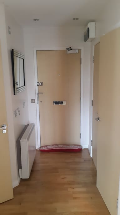Hallway & Front Door with security locks. Hallway cupboard with hanging space for coats and shoes