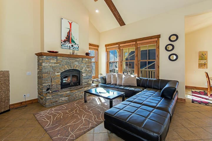 Chic living room with stone fireplace