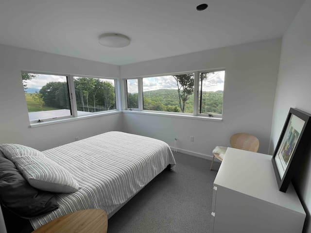 Bedroom one, with en-suite bath on the 3rd floor. Wake up to incredible views. Blackout shades will be added.