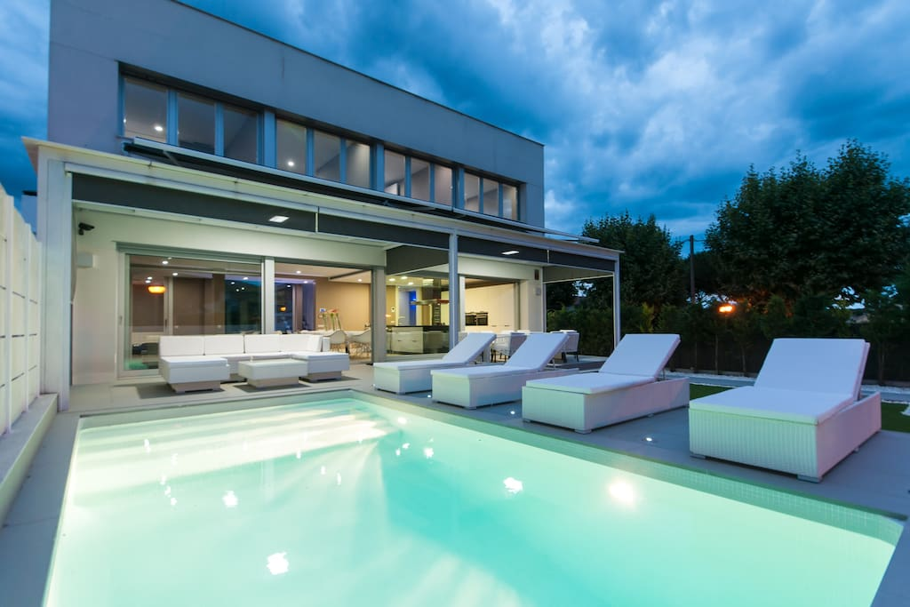 pool and house view by night