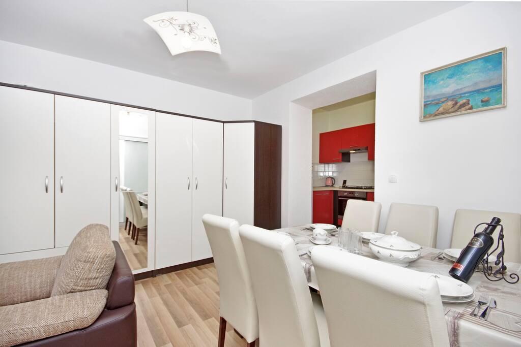 Wardrobe, kitchen, seating area