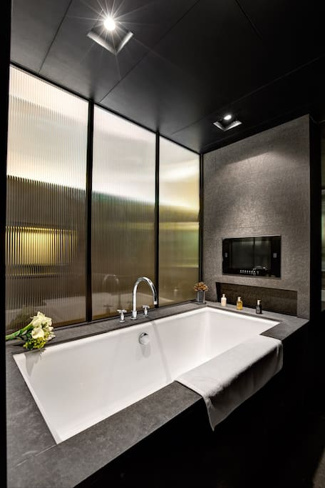 Full-Size Soaking Tub with separate Rain Shower and LCD TV