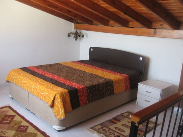 Loft with double bed, access to terrace.