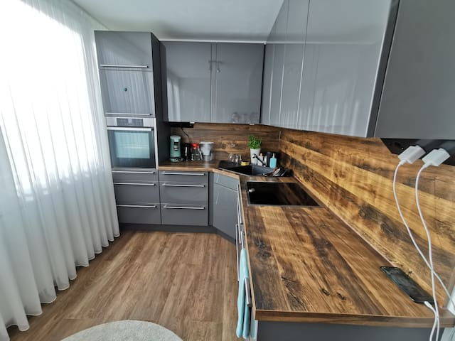City apartment with balcony, grill and parking