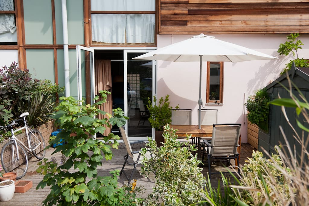 Kitchen leads to private patio in off street courtyard