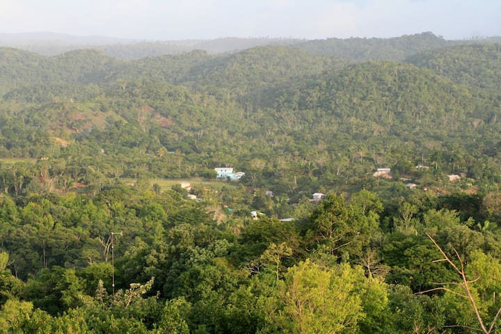 Looking over the village of Seven Miles from the top of Checo Hill - the village shop is a ten minute walk from the guesthouse