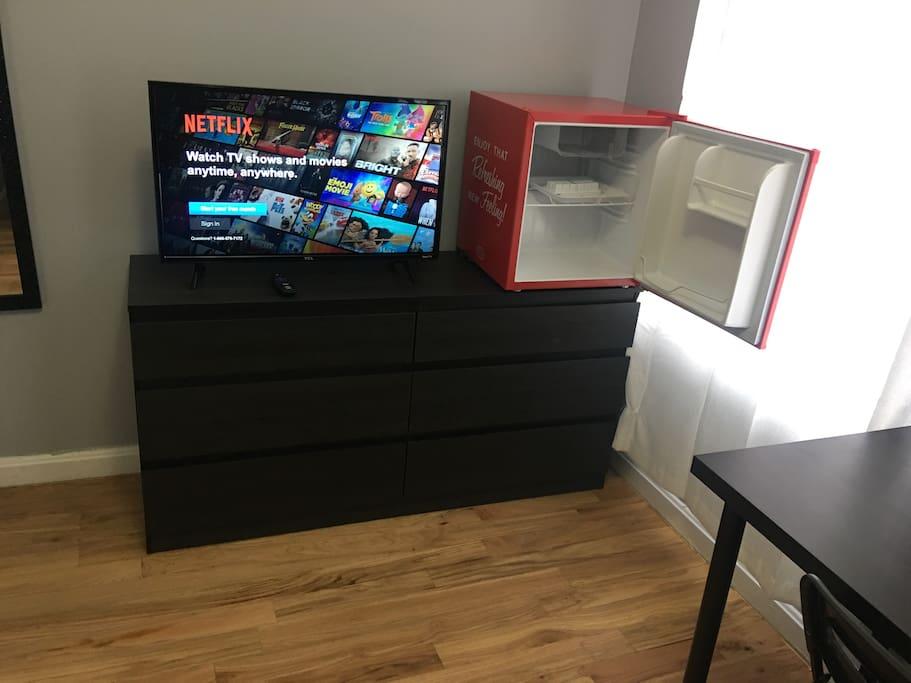 Bedroom with minifridge and smart TV
