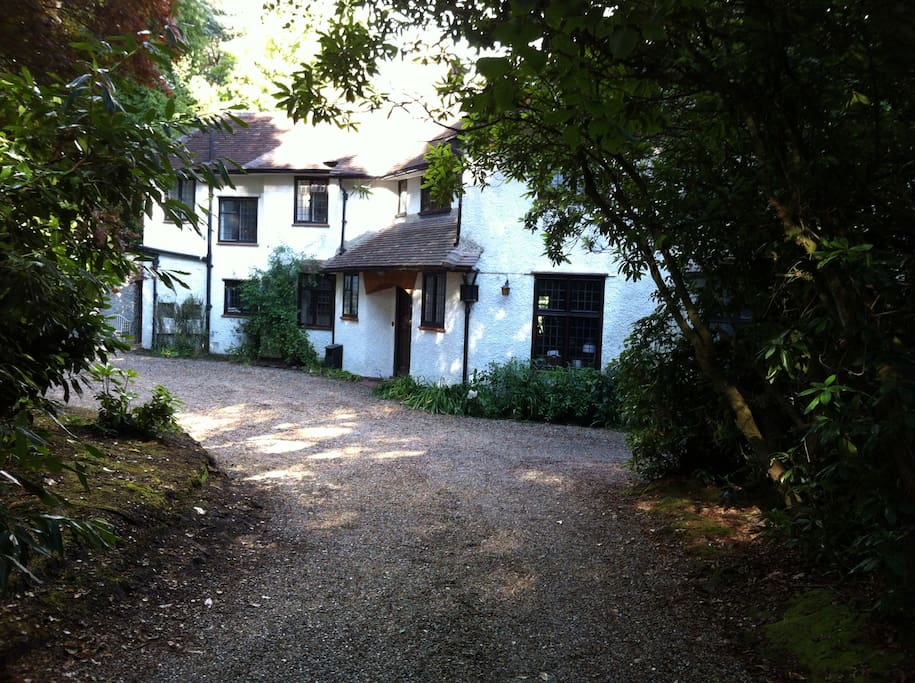 Driveway with ample of parking. Entrance to guest accommodation is at the far left of the house.