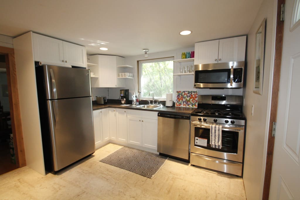 Kitchen is fully equipped with over the range microwave, dishwasher, fridge, toaster, coffeemaker  and gas stove.