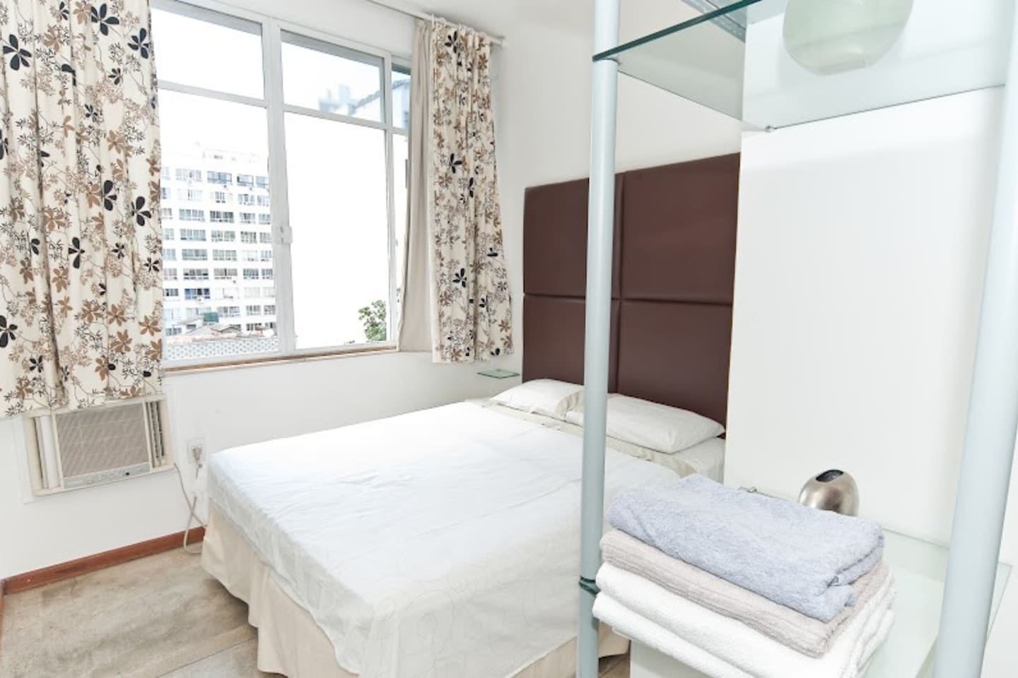 Bedroom with double size bed and air conditioning