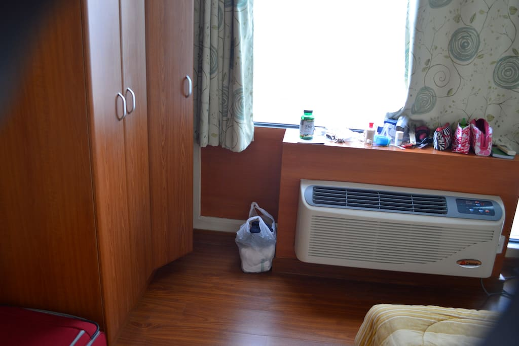 This is the Master's BR with it's own a/c unit, and double bed and cabinets.