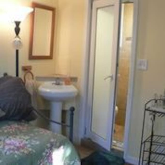 Private bathroom with shower off of bedroom.