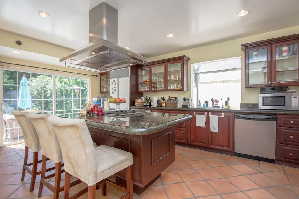 Our wonderful open kitchen with a built in gas grill!