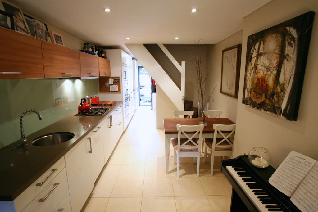 Kitchen / Dining - European kitchen with integrated appliances, dishwasher, microwave, dining setting for 4