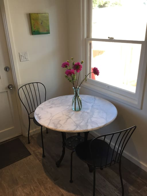 Breakfast nook and good space for working on a laptop.