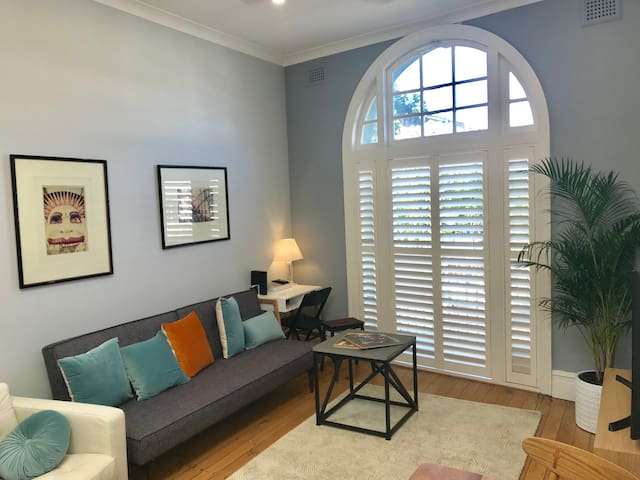 Large Living Area with ample Lounge Seating. The French Doors open to a Juliet Balcony with elevated Street & City Views. The Apartment has reverse-cycle Air-conditioning but there is an overhead Ceiling Fan in this area if you prefer fresh air.